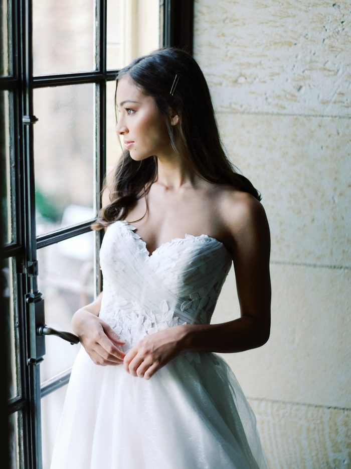 Real Bride Wearing Ruched Floral Wedding Dress Called Remy by Rebecca Ingram