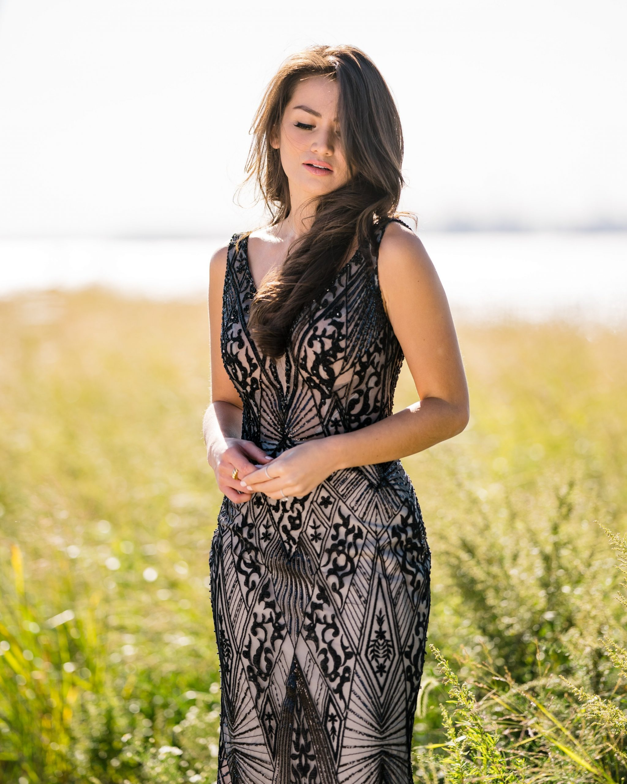 Influencer Caila Quinn Wearing Black Sheath Wedding Dress Called Elaine by Maggie Sottero