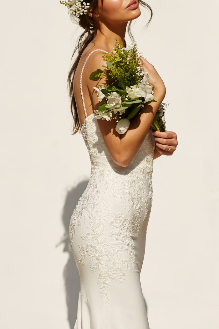Model wearing simple sheath wedding dress Aubrey by Rebecca Ingram in a Spanish-Inspired Wedding Shoot
