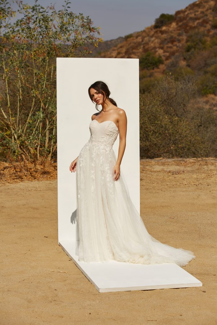 Model wearing Ruched Princess Wedding Gown called Flora by Rebecca Ingram in a Spanish-inspired Wedding Shoot