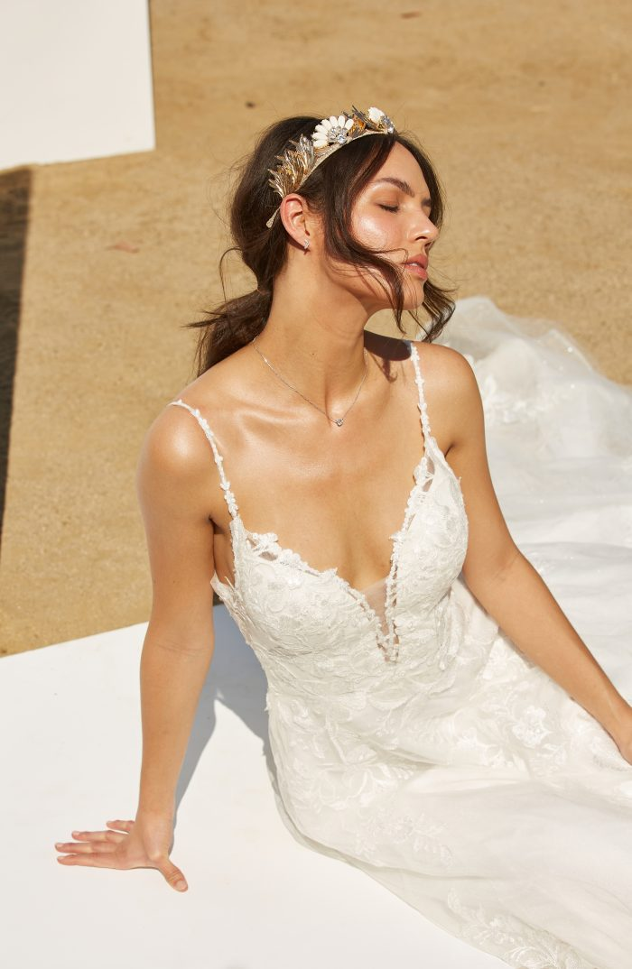 Model wearing lace A-line Wedding Dress Called Ellen by Rebecca Ingram in a Spanish-inspired Wedding Shoot