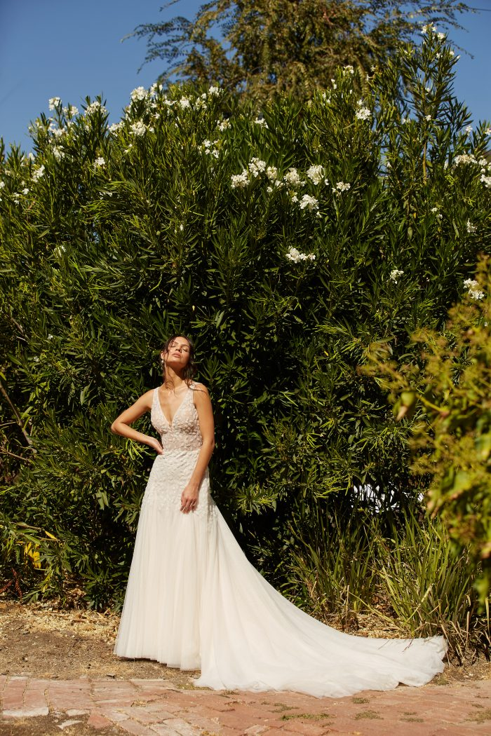Model wearing Lace Fit-and-Flare Wedding Dress called Geneva by Maggie Sottero in a Spanish-inspired Wedding Shoot