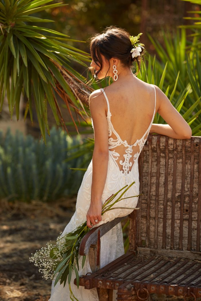 Model wearing Sexy Low-back Wedding Dress called Esther by Maggie Sottero in a Spanish-inspired Wedding Shoot
