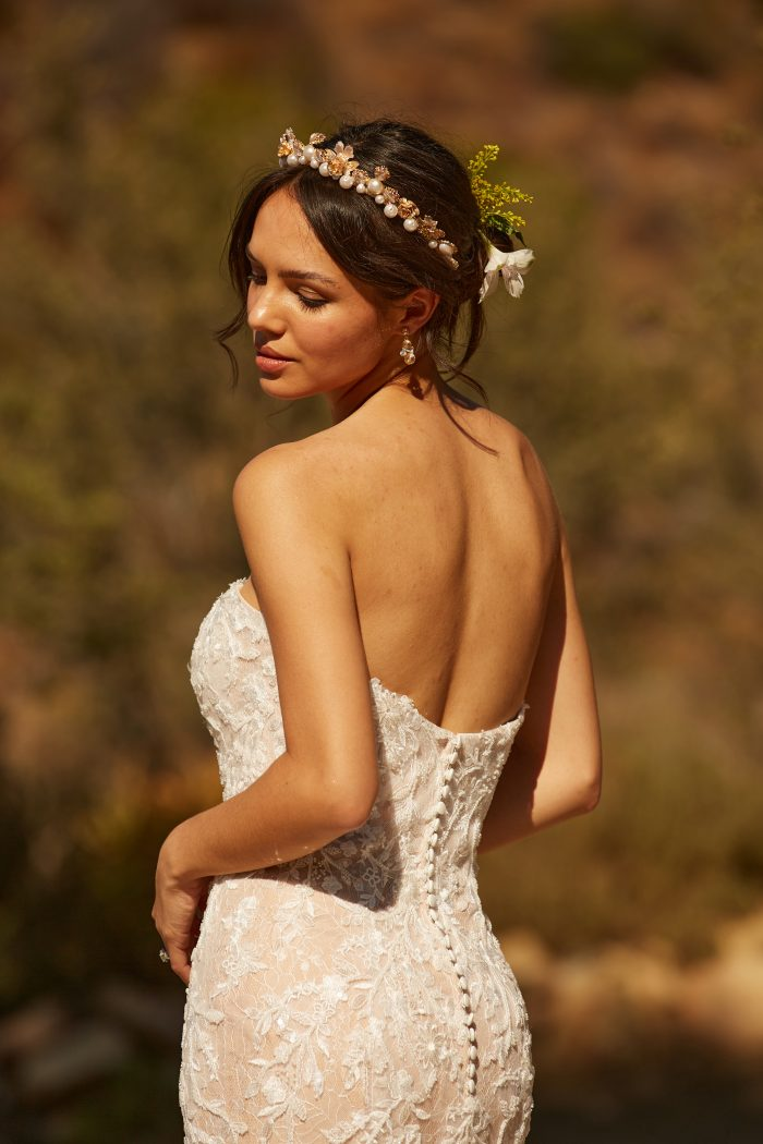 Model wearing Lace Mermaid Wedding Dress called Charmaine by Maggie Sottero in a Spanish-inspired Wedding Shoot