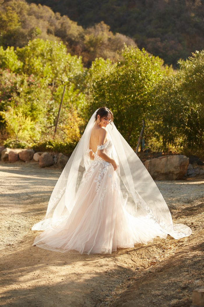 Model wearing Princess Wedding Dress called Orlanda by Maggie Sottero in a Spanish-inspired Wedding Shoot