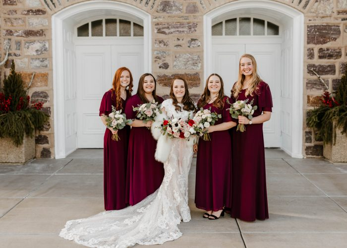 Real Bride Wearing Maggie Sottero Wedding Dress at Winter Wedding with Bridesmaids Wearing Berry Tone Dresses