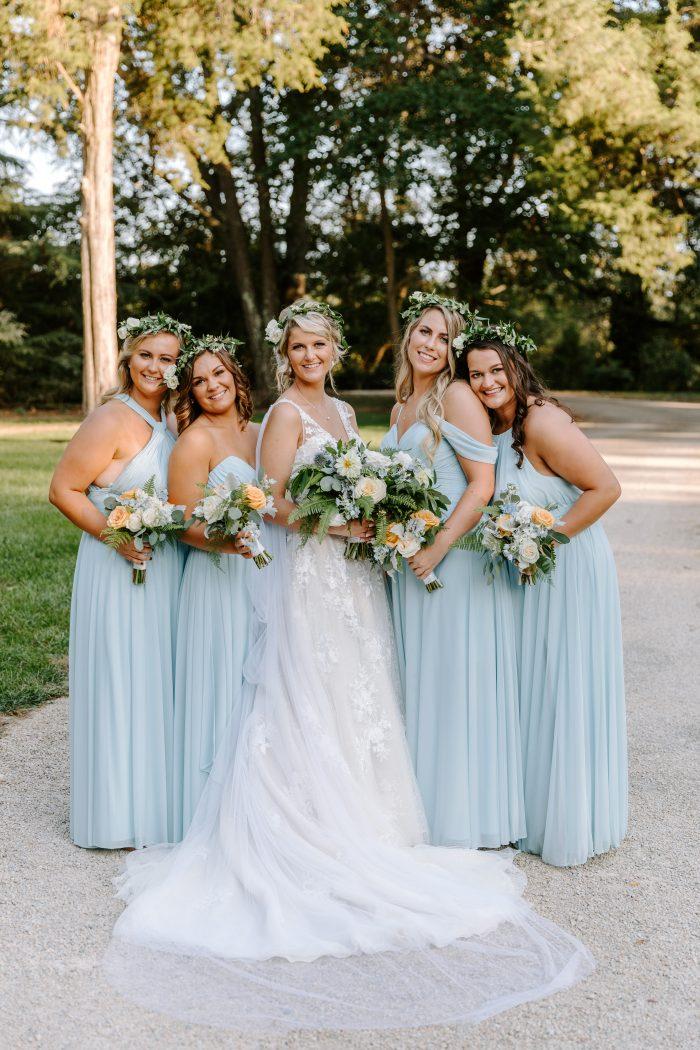 Real Bride Wearing Meryl Wedding Dress with Bridesmaids Wearing Blue Dresses for Summer Wedding
