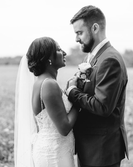 BBride and Groom bridal portraits with Bride wearing Nola lace sheath wedding dress by Maggie Sottero