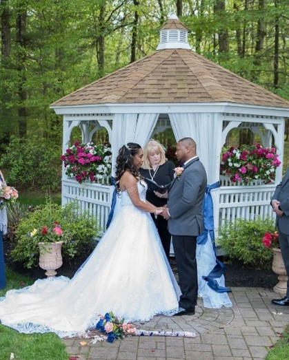 Real Bride and Groom with bride wearing a Maggie Sottero gown in a garden wedding