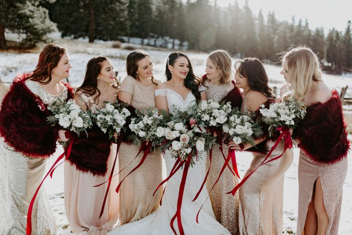 Real Bride Wearing Maggie Sottero Wedding Dress at Winter Wedding with Bridesmaids