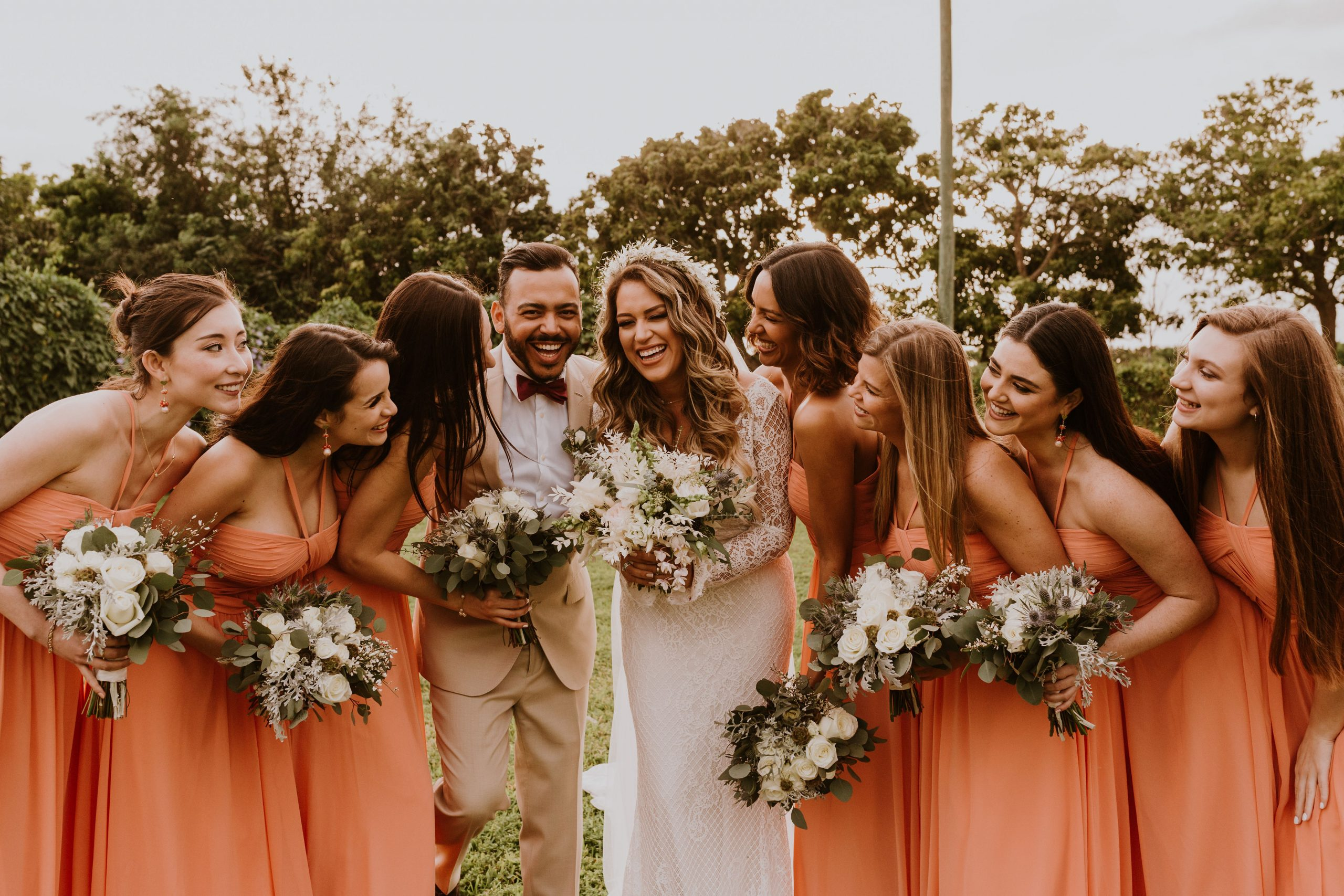 Bride Laughing with Her Bridesmaids Wearing Peach Bridesmaid Dress Ideas
