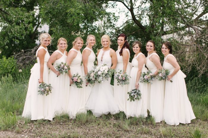 Real Bride Wearing Veda Wedding Dress with Bridesmaids Wearing White Dresses
