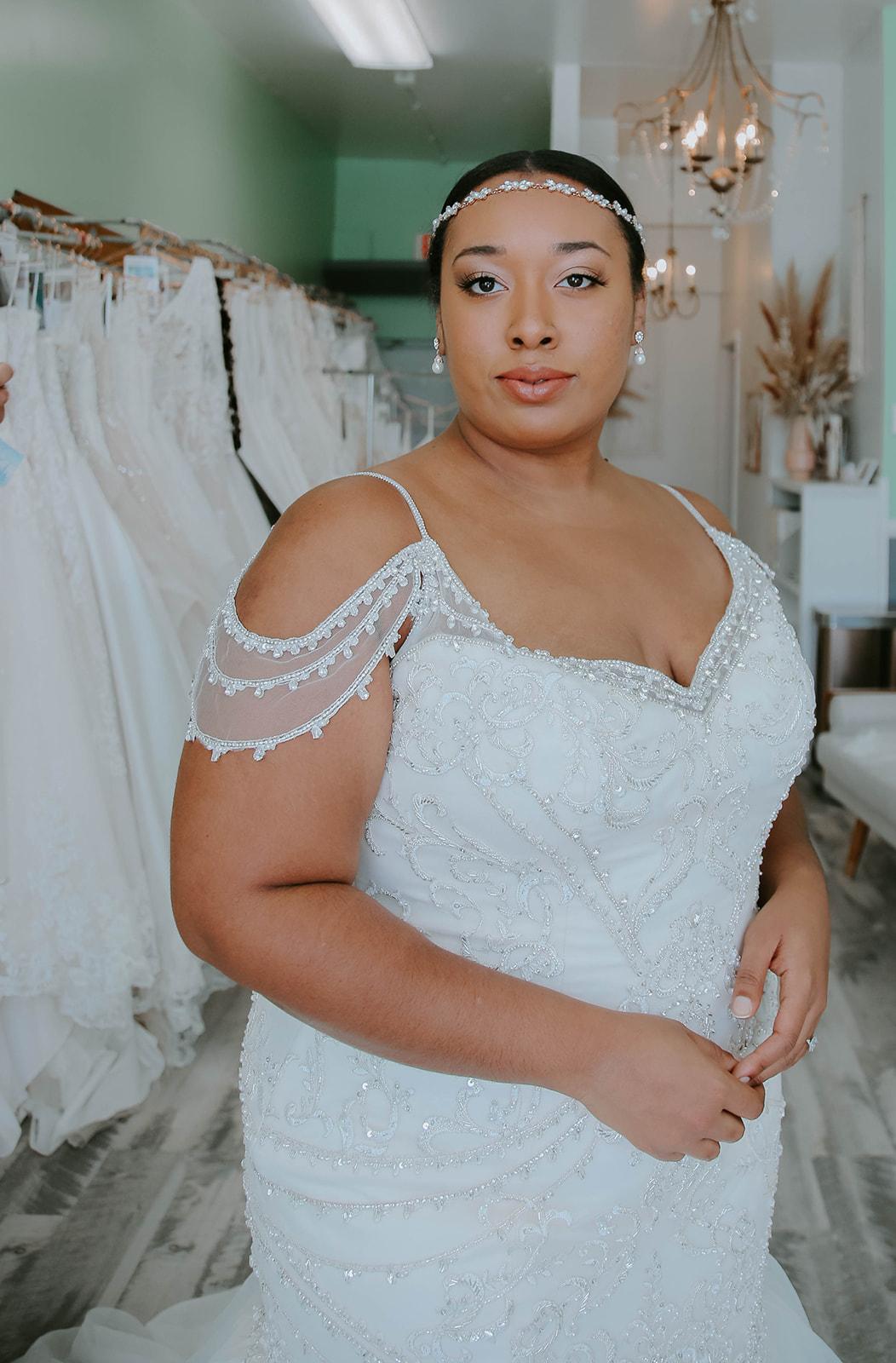 Model wearing Brinkley Lynette Off the Shoulder Wedding Dress by Maggie Sottero