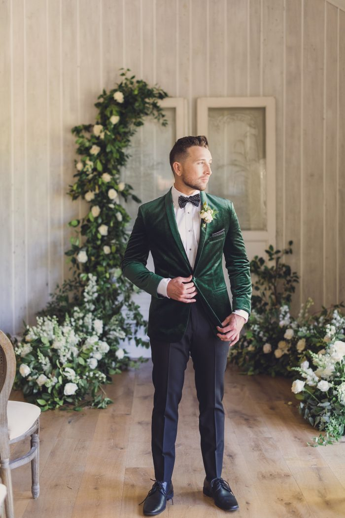 Groom wearing a green velvet suit jacket and black pants for a Luxe Spring Wedding