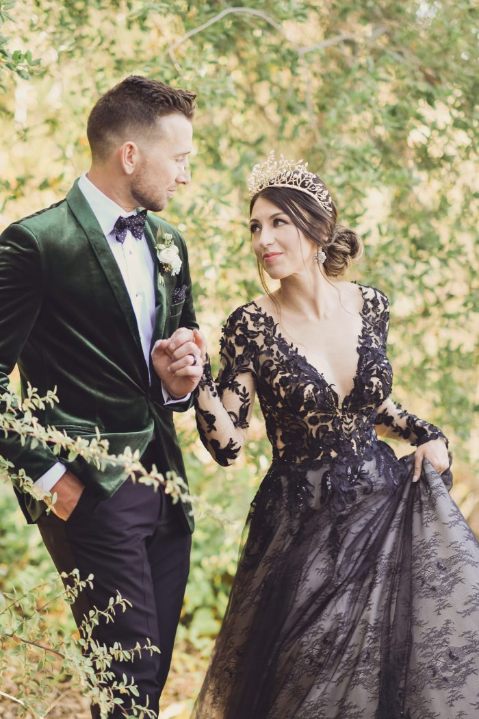 Model wearing Black Lace Wedding Gown called Zander by Sottero and Midgley and Groom in a Green Velvet suit for a Luxe Spring Wedding
