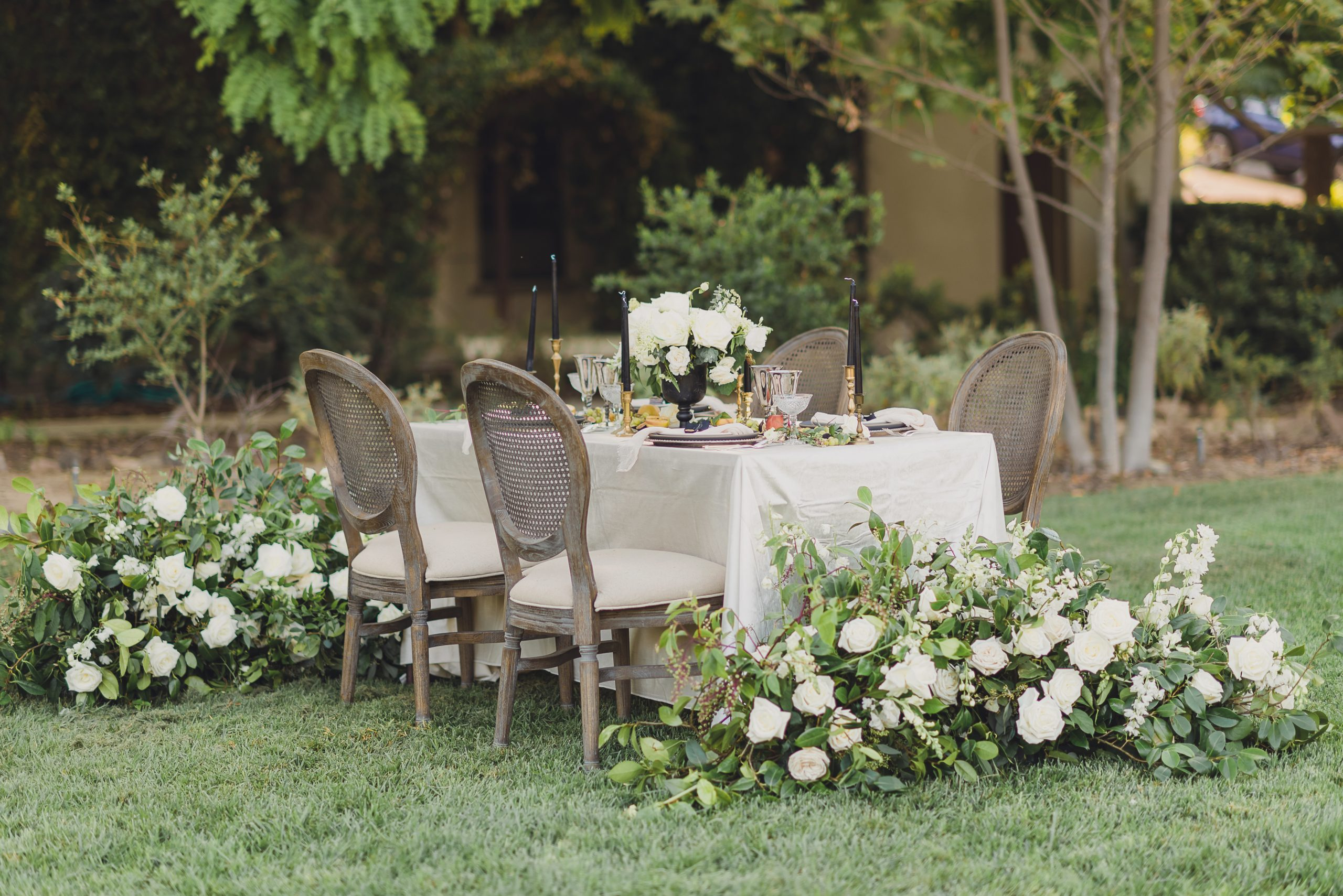 Outdoor spring wedding table setting with white florals