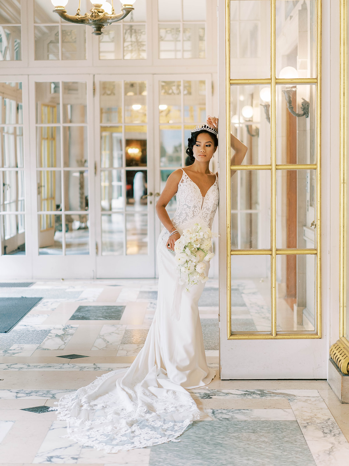 Model wearing Sophisticated Lace and Crepe Wedding Dress with a Hint of Sexy: Nikki by Maggie Sottero in a royal inspired shoot