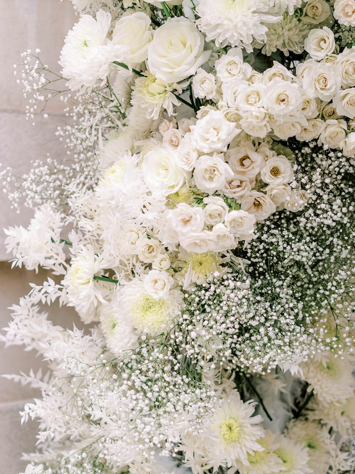 White flowers on an arch for a royal inspired wedding