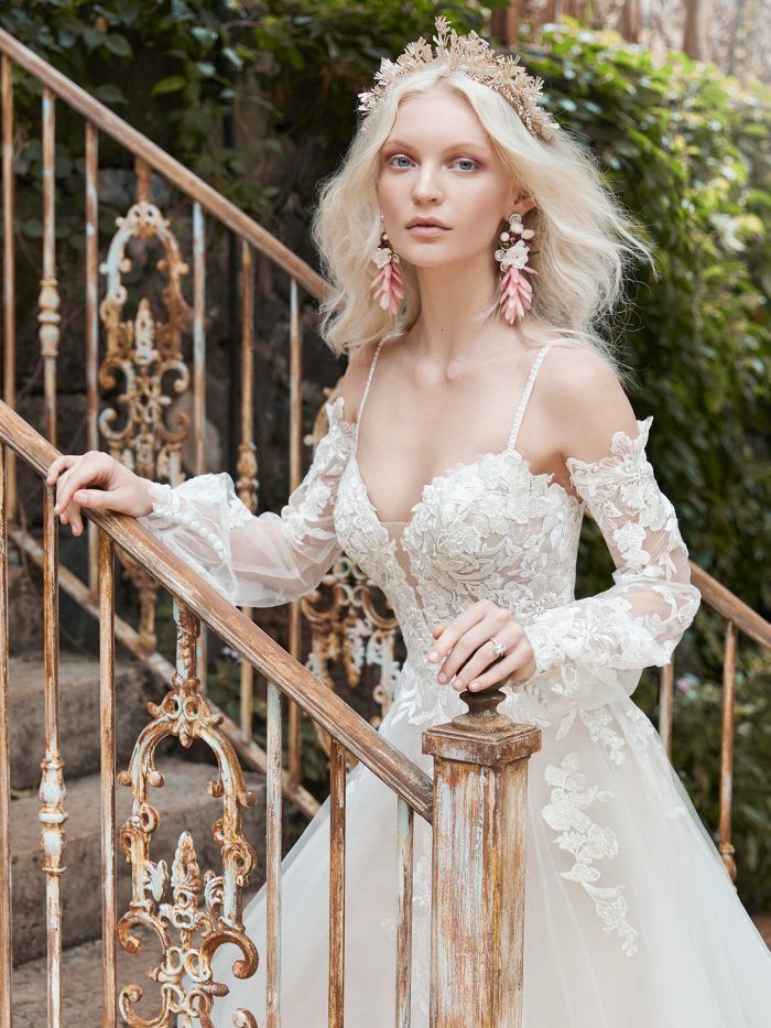 Model wearing Chic Long Sleeve Princess Bridal Dress Stevie by Maggie Sottero