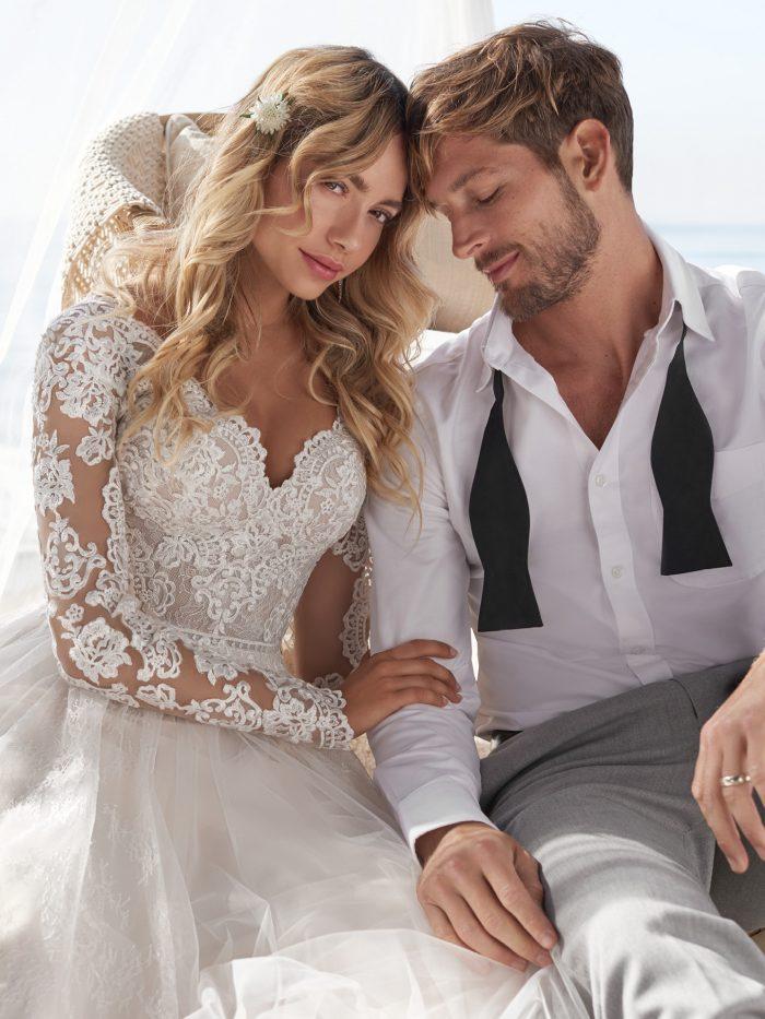 Model wearing Lace Sheath wedding dress called Iris