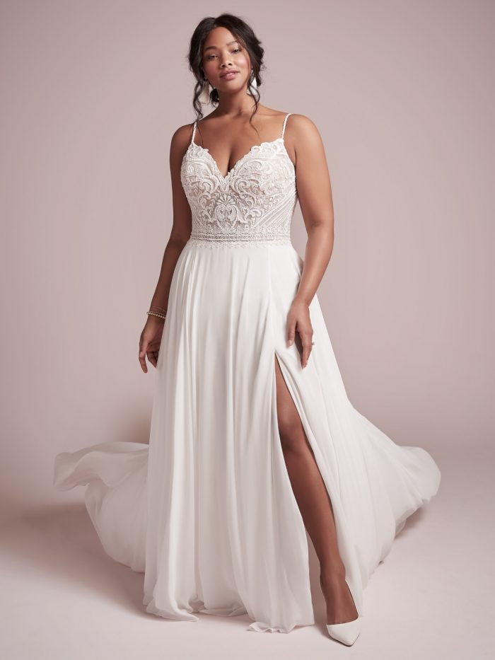 Model wearing Chiffon Sheath Beachy Wedding Dress Lorraine by Rebecca Ingram