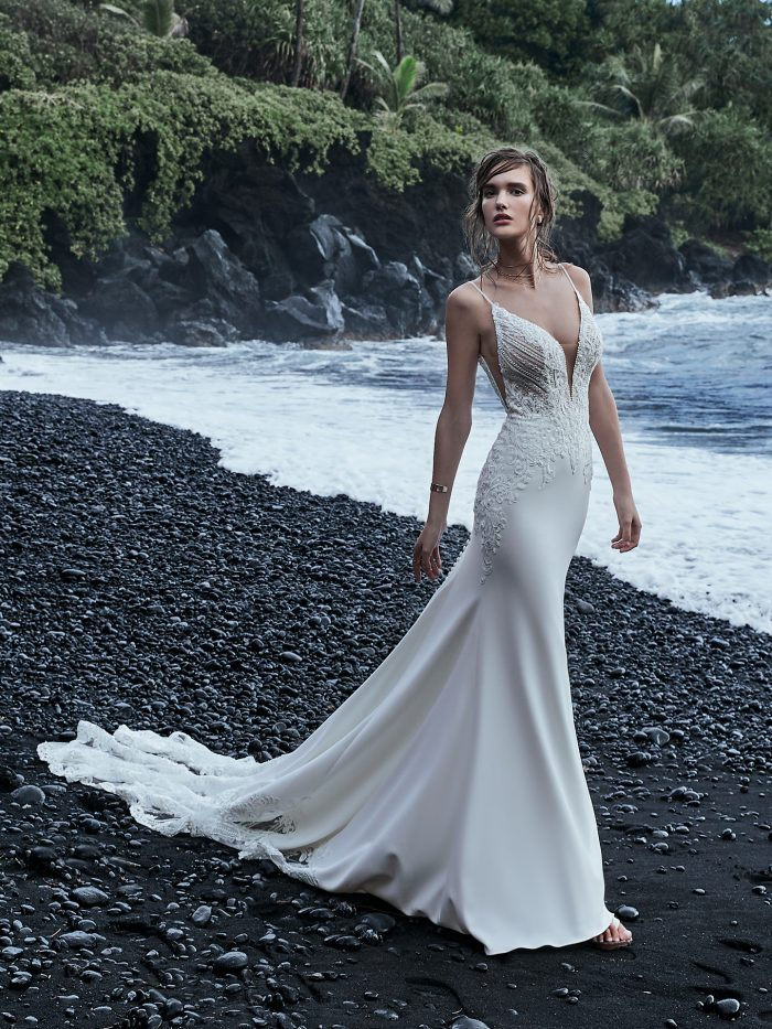 Model wearing Crepe Cold Shoulder Wedding Gown Bracken by Sottero and Midgley on the black sand beaches of Hawaii