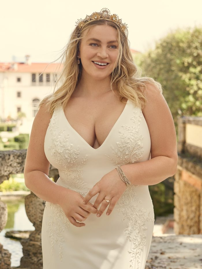 Bride Wearing Sexy Crepe Wedding Dress for Apple Shape Body Types Called Adrianna by Maggie Sottero