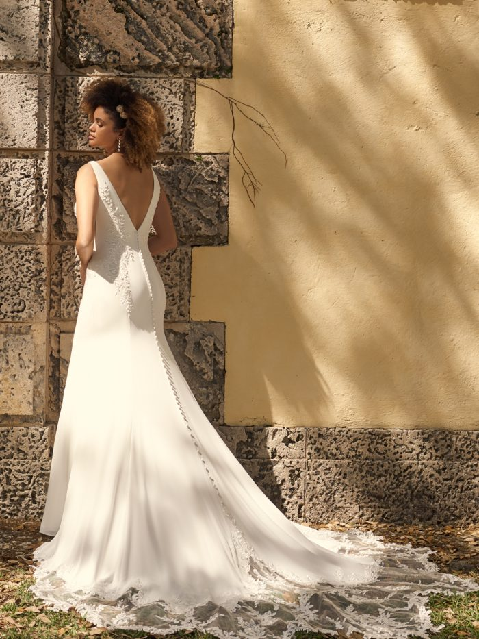 Bride Wearing V-back Crepe Wedding Gown Called Adrianna by Maggie Sottero