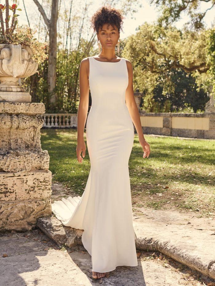 Bride Wearing Bateau Neckline Crepe Sheath Wedding Dress for Full-Chested Brides Called Fernanda Lynette by Maggie Sottero