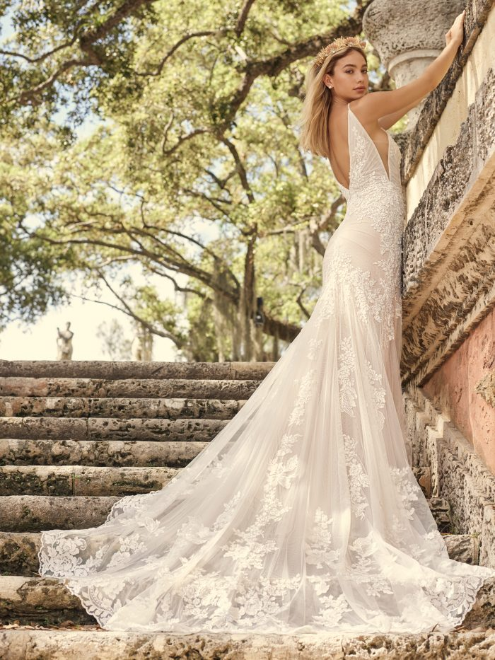 Bride Wearing Statement Back Wedding Dress with Long Bridal Train Called Fontaine by Maggie Sottero