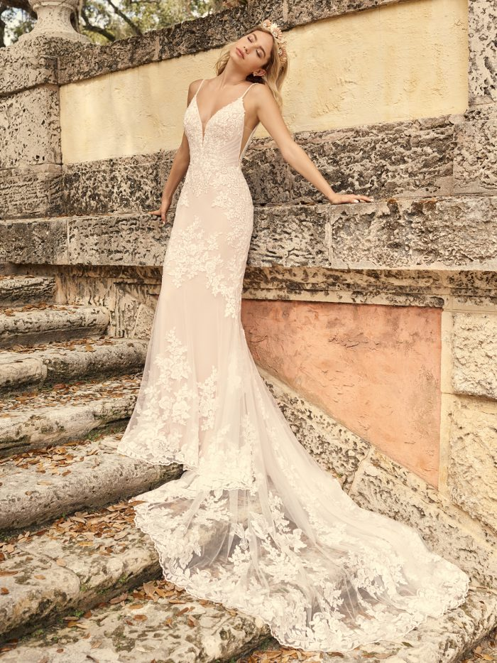 Bride Wearing Lace Sheath Wedding Dress with a Long Wedding Dress Train Called Fontaine by Maggie Sottero