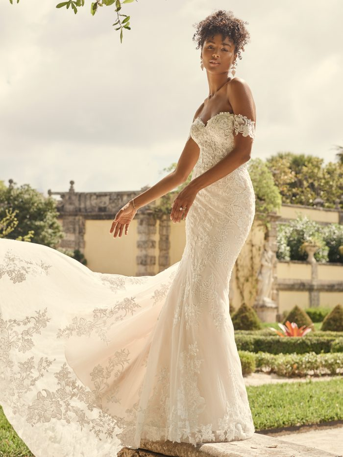 Bride Wearing Off-the-Shoulder Bridal Gown with Long Train Called Katell by Maggie Sottero