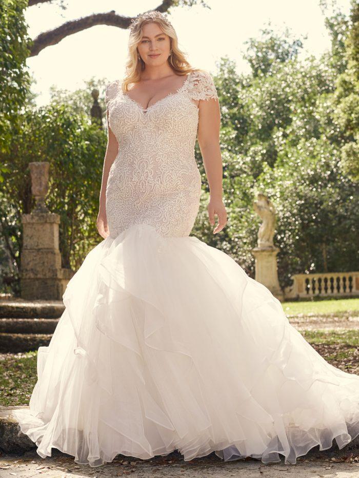 Bride Wearing Plus-Size Trumpet Wedding Dress Called Lunaria by Maggie Sottero