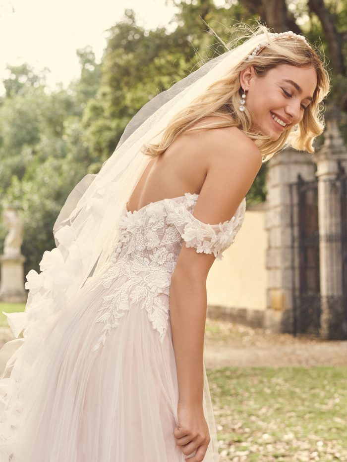 Bride Wearing Boho A-Line Wedding Dress with 3-D Flowers Called Mirra by Maggie Sottero