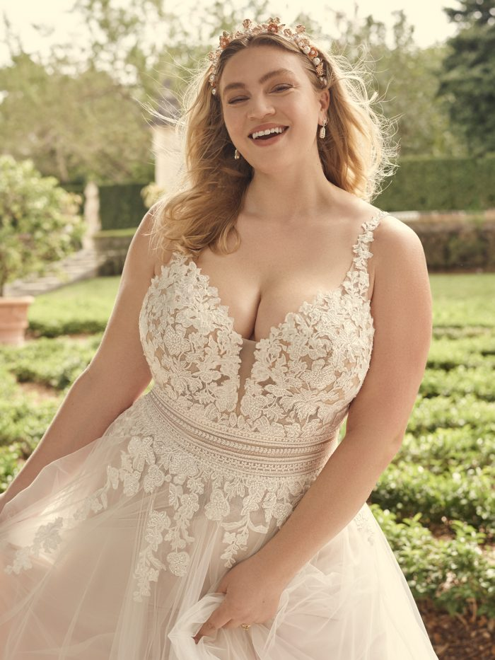 Bride Wearing Wedding Dress For Apple Shaped Plus Size Brides Called Ohara by Maggie Sottero
