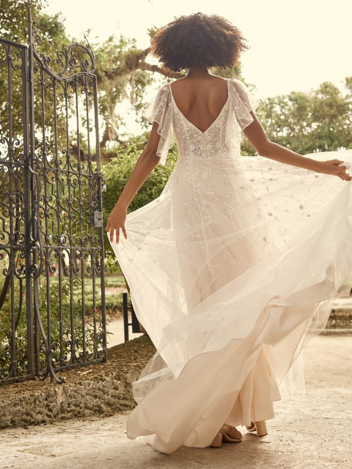 Bride Wearing Flutter Sleeve A-line Bridal Dress for Pear-Shaped Body Types Called Paige by Maggie Sottero
