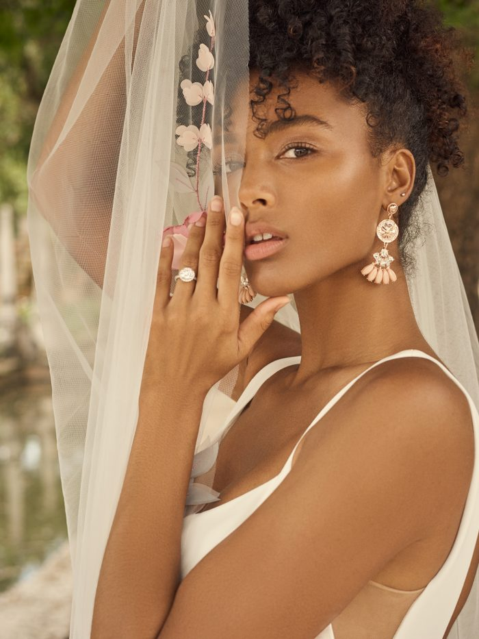 Bride Wearing Wedding Veil with Art Deco Drop Bridal Earrings Called Alanis by A'El Este and Maggie Sottero