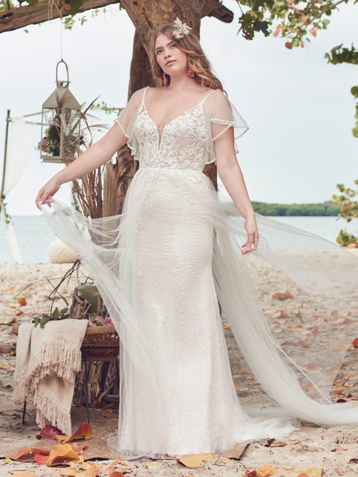 Bride Wearing Crepe Wedding Dress with Flutter Sleeves Called Fantasia by Rebecca Ingram