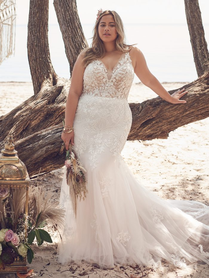 Bride Wearing Plus-Size Sparkly V-neck Mermaid Wedding Dress Called Faustine by Rebecca Ingram