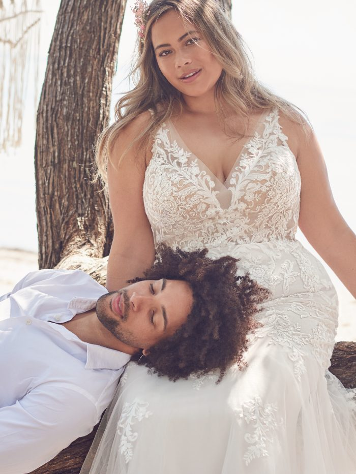 Bride with Groom Wearing Plus-Size Sparkly V-neck Mermaid Wedding Dress Called Faustine by Rebecca Ingram