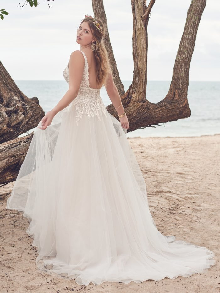 Bride on Beach Wearing Boho A-line Wedding Dress Called Isabella by Rebecca Ingram