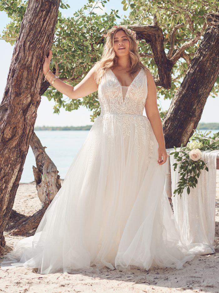 Bride Wearing Affordable Plus-Size A-Line Wedding Dress Called Jenessa by Rebecca Ingram