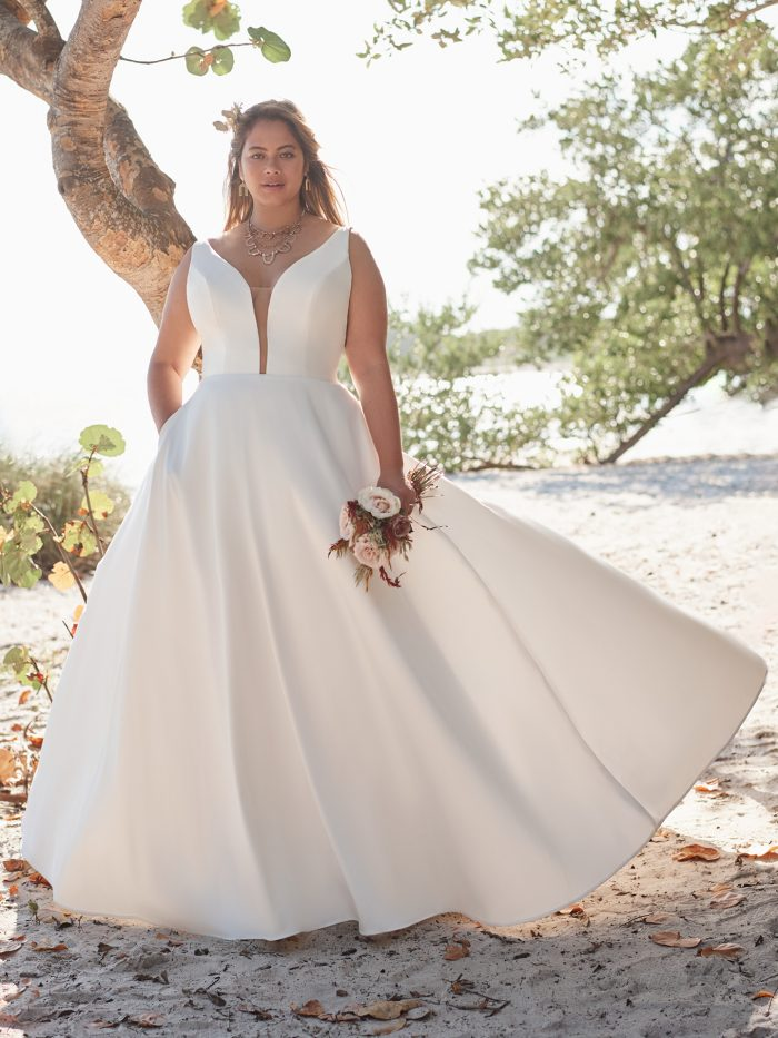 Bride Wearing Plus-Size Satin Ball Gown Wedding Dress Called Pearl by Rebecca Ingram