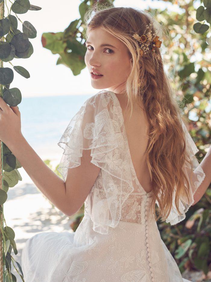 Bride Wearing Butterfly Lace Flutter Sleeve Wedding Dress Called Rubena by Rebecca Ingram
