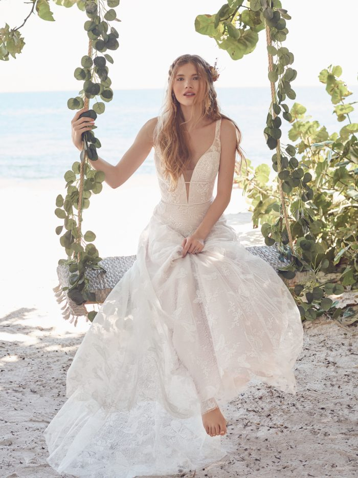 Bride on Swing Wearing Butterfly Lace A-line Bridal Gown Called Rubena by Rebecca Ingram