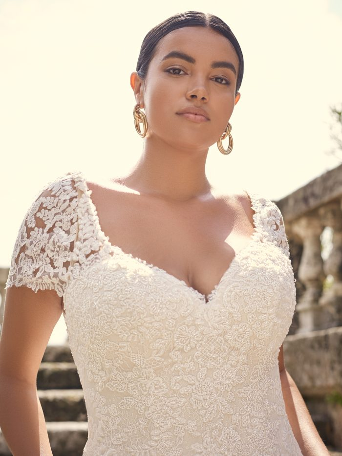 Bride Wearing Plus Size Lace Wedding Dress with Detachable Vintage Lace Cap Sleeves Called Dublin Lynette by Sottero and Midgley
