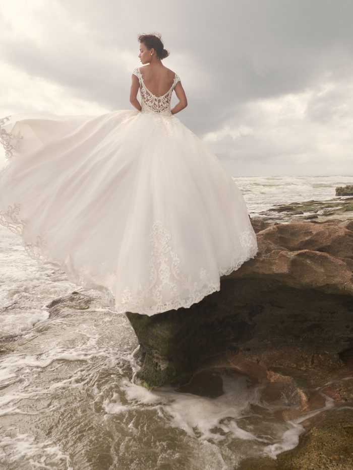 Bride on Beach Wearing Wedding Dress with Overskirt Called Jada by Sottero and Midgley