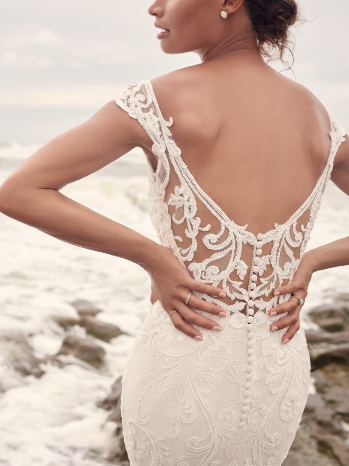 Bride on Beach Wearing Sparkly Sheath Wedding Gown Called Jada by Sottero and Midgley