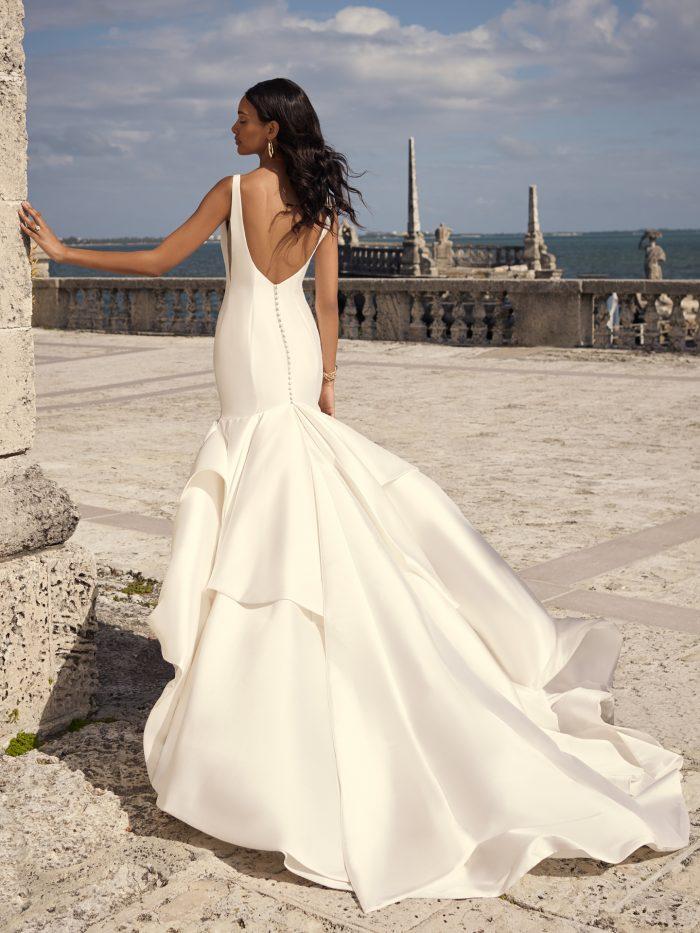 Bride Wearing Satin Mermaid Wedding Dress Called Kitara by Sottero and Midgley