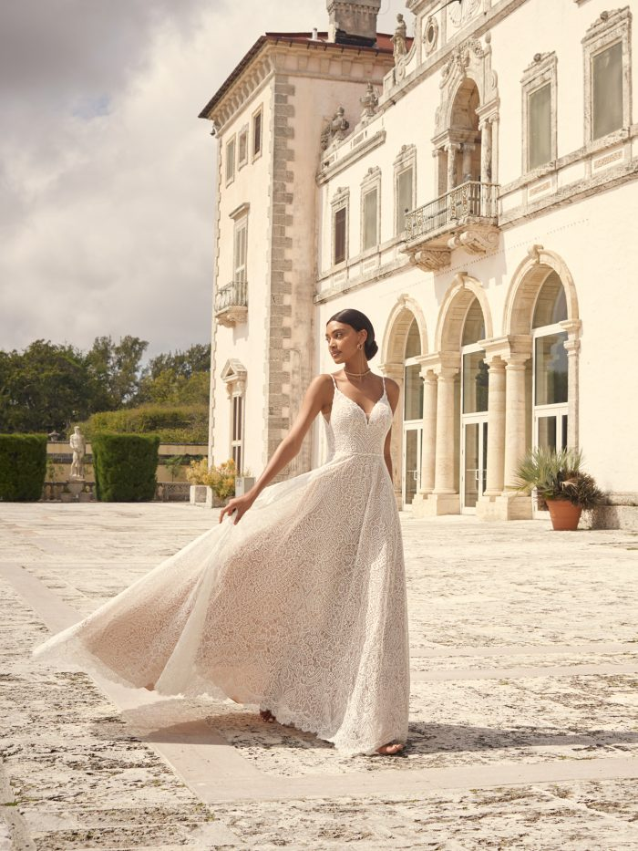 Bride at Elegant Venue Wearing Dramatic A-line Wedding Dress Called Petra by Sottero and Midgley